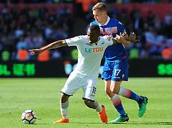 Jordan Ayew of Swansea City tries to hold off Ryan Shawcross of Stoke City-Mandatory by-line: Nizaam Jones/JMP- 13/05/2018 - FOOTBALL - Liberty Stadium - Swansea, Wales - Swansea City v Stoke City - Premier League