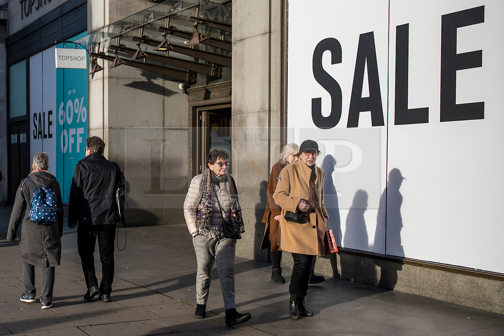 """© Licensed to London News Pictures. 22/12/2018. London, UK. Christmas shoppers on Oxford Street as many retailers begin sales early. High street retailers are hoping for strong sales as last-minute Christmas shoppers hit the streets for """"Super Saturday"""". Photo credit: Rob Pinney/LNP"""