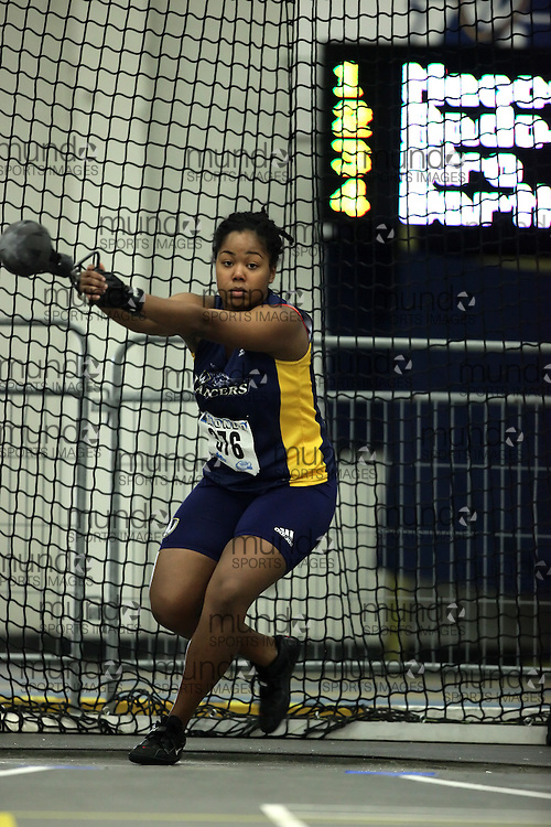 (Windsor, Ontario---11 March 2010) Steffi Stephenson of University of Windsor Lancers competes in the  competes in the weight throw at the 2010 Canadian Interuniversity Sport Track and Field Championships at the St. Denis Center. Photograph copyright Geoff Robins/Mundo Sport Images. www.mundosportimages.com
