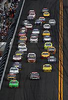Feb 24, 2013; Daytona Beach, FL, USA; NASCAR Sprint Cup Series driver Danica Patrick (10) leads the field into the tri-oval during the Daytona 500 at Daytona International Speedway.