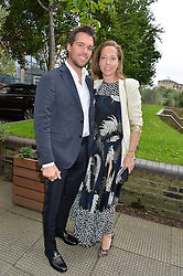 ADAM KELLY and MIA FENWICK at an Evening at The River Cafe in aid of the NSPCC held at The River Cafe, Thames Wharf, Rainville Road, London on 19th June 2016