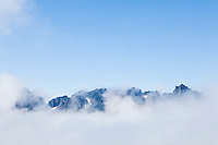 Mother Mountains obscured by low clouds, Mount Rainier National Park, Washington, USA.