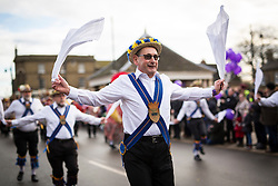 DATE CORRECTION. IMAGES SHOT 14/01/2017 © Licensed to London News Pictures. 14/01/2017. Whittlesey UK.Picture shows a member of the Peterborough Morris dancers at the 38th Whittlesey Straw Bear Festival this weekend. In times past when starvation bit deep the ploughmen of the area where drawn to towns like Whittlesey, They knocked on doors begging for food & disguised their shame by blackening their faces with soot. In Whittlesey it was the custom on the Tuesday following Plough Monday to dress one of the confraternity of the plough in straw and call him a Straw Bear. The bear was then taken around town to entertain the folk who on the previous day had subscribed to the rustics, a spread of beer, tobacco & beef. The bear was made to dance in front of houses & gifts of money, beer & food was expected. Photo credit: Andrew McCaren/LNP