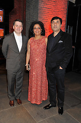 Left to right, JUSTIN FORSYTH Chief Executive of Save The Children, RITU KAPOOR and RAKESH KAPOOR Chief Executive of Reckitt Benckiser plc sponsors of the evening at A Night of Funk & Soul in aid of Save The Children held at The Roundhouse, Camden, London on 20th March 2013.
