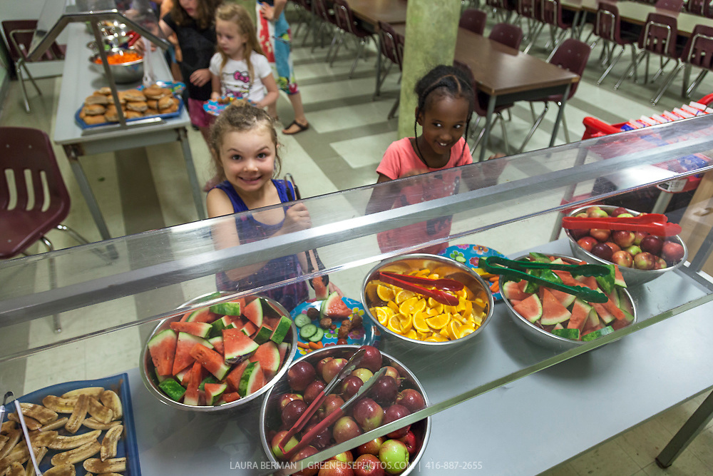 Students enjoying the fresh vegetables and fruit salad bar in the Student Nutrition program at James S. Bell Middle School, Toronto