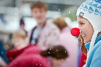 JEROME A. POLLOS/Press..Renae Bopray wore a clown nose for warmth and comic relief before diving into the 35-degree water of Lake Coeur d'Alene for the Polar Bear Plunge.