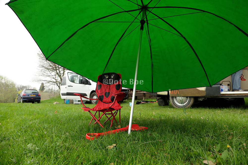 child chair with large parasol