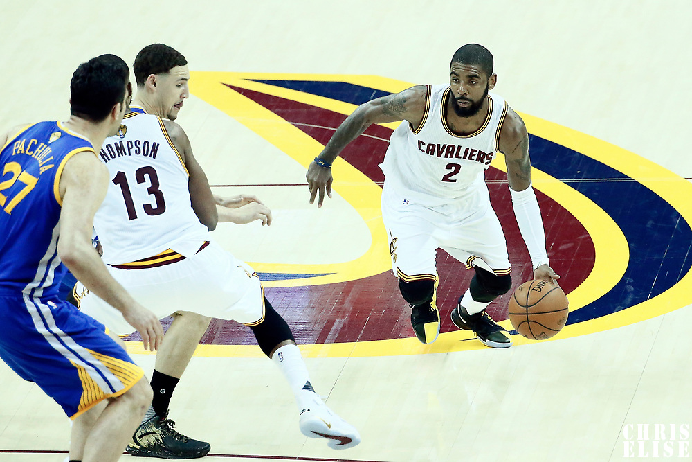 07 June 2017: Cleveland Cavaliers guard Kyrie Irving (2) drives past Golden State Warriors guard Klay Thompson (11) on a screen set by Cleveland Cavaliers center Tristan Thompson (13) during the Golden State Warriors 118-113 victory over the Cleveland Cavaliers, in game 3 of the 2017 NBA Finals, at  the Quicken Loans Arena, Cleveland, Ohio, USA.