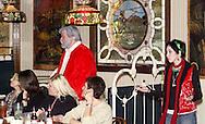 "Santa Claus (aka Jerry Francis of Dayton) and daughter Krystal (right, aka Alisha McDarris) during Mayhem & Mystery's production of ""I'll Be Home Shopping for Christmas"" at the Spaghetti Warehouse in downtown Dayton, Monday, November 9, 2009."