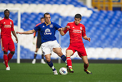 LIVERPOOL, ENGLAND - Tuesday, March 6, 2012: Liverpool's Conor Coady in action against Everton's Leon Osman during the FA Premier Reserve League match at Goodison Park. (Pic by David Rawcliffe/Propaganda)