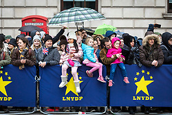 © Licensed to London News Pictures. 01/01/2018. London, UK. Spectators brave the weather to watch the New Year's Day Parade in Central London. Photo credit: Rob Pinney/LNP