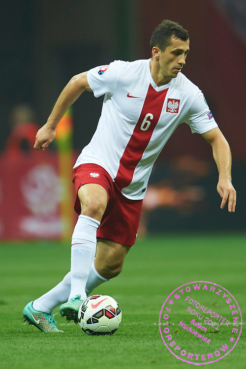 Poland's Tomasz Jodlowiec controls the ball during the EURO 2016 qualifying match between Poland and Germany on October 11, 2014 at the National stadium in Warsaw, Poland<br /> <br /> Picture also available in RAW (NEF) or TIFF format on special request.<br /> <br /> For editorial use only. Any commercial or promotional use requires permission.<br /> <br /> Mandatory credit:<br /> Photo by &copy; Adam Nurkiewicz / Mediasport