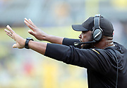 Pittsburgh Steelers head coach Mike Tomlin waves his arms as he yells out from the sideline during the 2016 NFL week 2 regular season football game against the Cincinnati Bengals on Sunday, Sept. 18, 2016 in Pittsburgh. The Steelers won the game 24-16. (©Paul Anthony Spinelli)