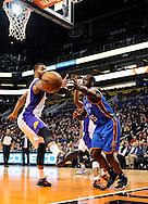 Jan. 14, 2013; Phoenix, AZ, USA; Oklahoma City Thunder guard Reggie Jackson (15) and the Phoenix Suns forward Markieff Morris (11) both reach for the ball in the first half at US Airways Center. Mandatory Credit: Jennifer Stewart-USA TODAY Sports.