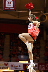 14 February 2015:   Redbird Cheerleader performing a routine during an NCAA MVC (Missouri Valley Conference) men's basketball game between the Wichita State Shockers and the Illinois State Redbirds at Redbird Arena in Normal Illinois