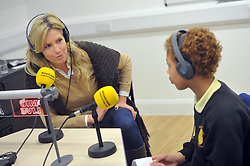 Image ©Licensed to i-Images Picture Agency. 18/12/2014. London, United Kingdom. <br /> <br /> Penny Lancaster visits Charlton Manor Primary School where the Mayors Fund initiative 'Penny for London' is raising money to fund breakfasts for school children.<br /> <br /> Penny Lancaster is interviewed for the school radio station.<br /> <br /> Picture by Ben Stevens / i-Images