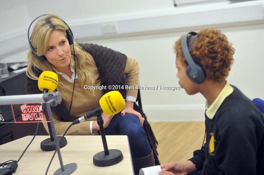 Image &copy;Licensed to i-Images Picture Agency. 18/12/2014. London, United Kingdom. <br /> <br /> Penny Lancaster visits Charlton Manor Primary School where the Mayors Fund initiative 'Penny for London' is raising money to fund breakfasts for school children.<br /> <br /> Penny Lancaster is interviewed for the school radio station.<br /> <br /> Picture by Ben Stevens / i-Images