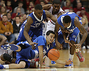 December 08, 2012: Indiana Hoosiers guard Maurice Creek (3), Central Connecticut State Blue Devils guard Andrew Hurd (3), Central Connecticut State Blue Devils guard Malcolm McMillan (11) and Central Connecticut State Blue Devils guard Matt Hunter (25) scramble for a loose ball in an NCAA basketball game between Central Connecticut State and Indiana University at Assembly Hall in Bloomington, Indiana. Indiana won 100-69.
