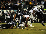 Dec 25, 2017; Philadelphia, PA, USA; Philadelphia Eagles defensive end Vinny Curry (75) and linebackers Mychal Kendricks (95), Nigel Bradham (53) tackle Raiders running back Marshawn Lynch (24) causing a fumble during a NFL football game at Lincoln Financial Field. The Eagles defeated the Raiders 19-10. Photo by Reuben Canales
