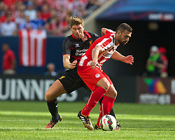 CHICAGO, USA - Sunday, July 27, 2014: Liverpool's captain Steven Gerrard in action against Olympiacos' Ionnis Maniatis during the International Champions Cup Group B match at the Soldier Field Stadium on day seven of the club's USA Tour. (Pic by David Rawcliffe/Propaganda)