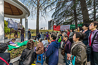 Shanghai, China - April 7, 2013: people singing revolutionary songs in fuxing park at the city of Shanghai in China on april 7th, 2013