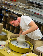 A patron creates pottery at Wheelhouse Studios (located on the lower level of Memorial Union) during the Madison World Music Festival on September 12, 2014.