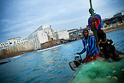 Fishermen set off to work at sunrise on their small traditional wooden boat near Cape Coast, roughly 120km west of Ghana's capital Accra on Thursday April 9, 2009. The Ghana Ministry of Fisheries estimates to about 500,000 the number of fishermen and fishmongers in Ghana. Up to 2 million people - nearly 10 percent of the country's population  - make a living from professions - such as canoe-building - dependent on the fishing industry.