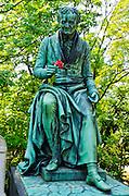 Statue on a grave at Père Lachaise Cemetery, Paris, France