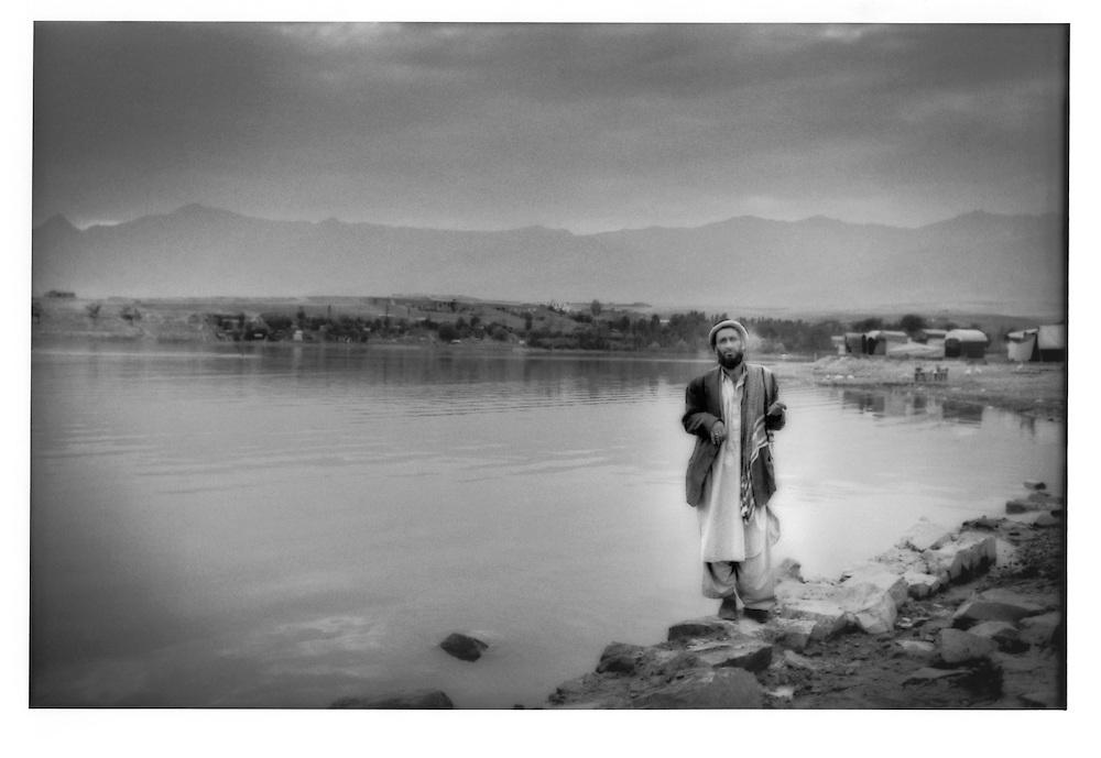 Grabbing a smoke on the shore of Ghargha Lake, Afghanistan.