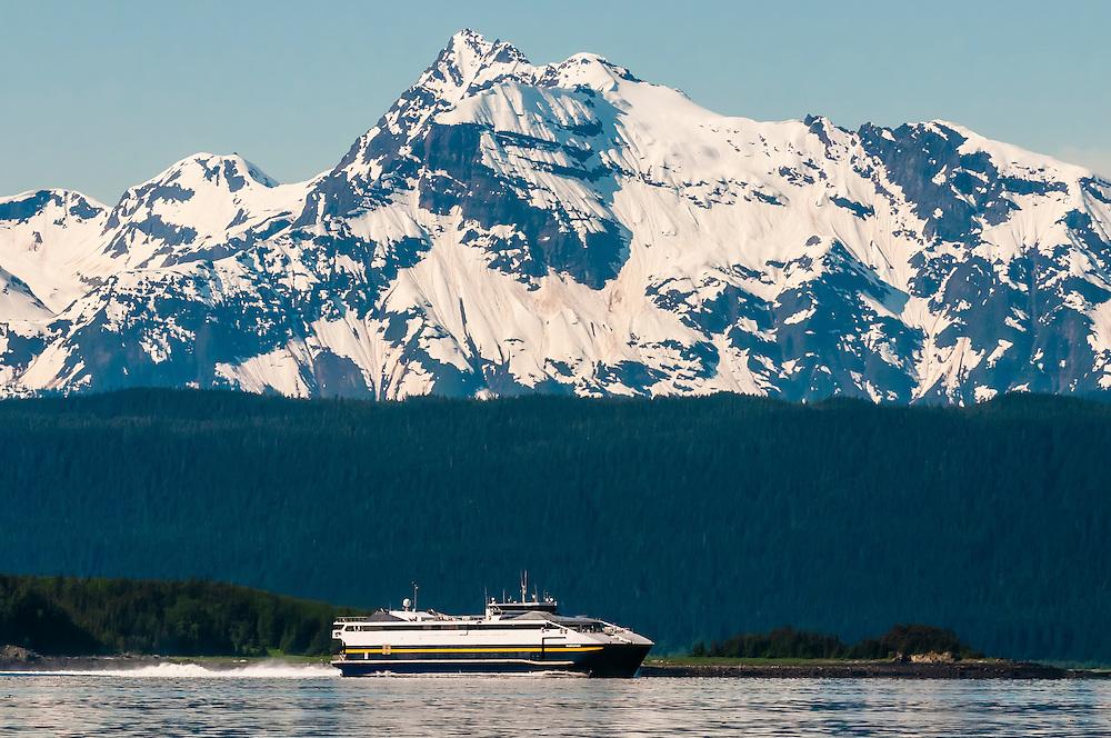 Alaska Marine Highway (a.k.a. Alaska State Ferry) ship MV Fairweather cruising down the Lynn Canal (deepest fjord in North America), near Juneau, Inside Passage, Southeast Alaska USA.