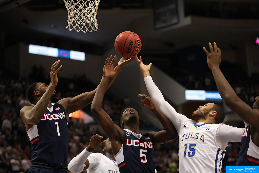 Marquel Curtis, (right), Tulsa, challenges for a rebound with Phillip Nolan, (left), Daniel Hamilton, UConn, during the UConn Huskies Vs Tulsa Semi Final game at the American Athletic Conference Men's College Basketball Championships 2015 at the XL Center, Hartford, Connecticut, USA. 14th March 2015. Photo Tim Clayton