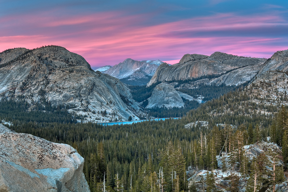 frontlit sunset illuminated teneya lake from olmstead point in yosemite national park.
