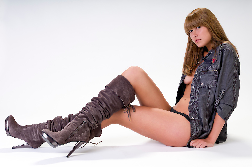 Very sensual woman semi-dressed looking at camera and seated.