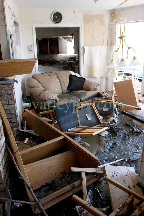 08 Sept 2005.  New Orleans, Louisiana. Hurricane Katrina aftermath. <br /> Venetian Isles in East New Orleans, where the tidal surge washed over the land and devastated homes and property. The Lala families mud filled flood ravaged home.<br /> Photo; &copy;Charlie Varley/varleypix.com