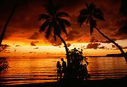 Couple at sunset, Musket Cove, Plantation Island, Fiji.