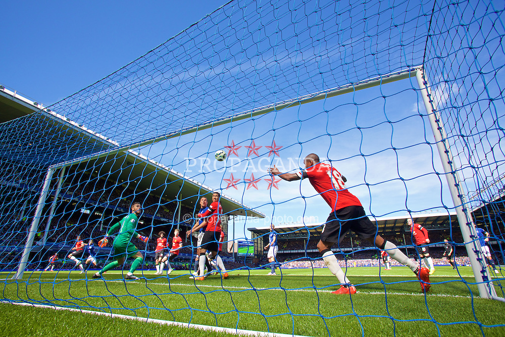 LIVERPOOL, ENGLAND - Sunday, April 26, 2015: Manchester United's Ashley Young cannot prevent Everton's John Stones from scoring the second goal during the Premier League match at Goodison Park. (Pic by David Rawcliffe/Propaganda)