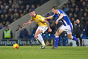 Bolton Striker Gary Madine wins the ball from Chesterfield defender Tom Anderson during the EFL Sky Bet League 1 match between Chesterfield and Bolton Wanderers at the Proact stadium, Chesterfield, England on 17 December 2016. Photo by Aaron  Lupton.