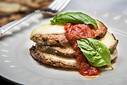 Delicious Eggplant Parmesan with marinara and fresh basil created by Chef Ray Willey of Take the Night Off in Ft. Lauderdale, Florida. Photography by Jeffrey A McDonald