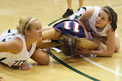 10 January 2009: Hope Schulte , Noelle Dryden, and Claire Sheehan scramble for a loose ball. The Lady Titans of Illinois Wesleyan University downed the and Lady Thunder of Wheaton College by a score of 101 - 57 in the Shirk Center on the Illinois Wesleyan Campus in Bloomington Illinois.