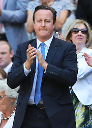 Prime Minister David Cameron applauds Andy Murray in the Royal Box at the start of the Men's Final at the Wimbledon Tennis Championships in  London, Sunday, 7th July 2013<br /> Picture by Stephen Lock / i-Images