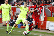 Crawley Town Striker Liam McAlinden (11) gets shoulder barged off the ball by Hartlepool United midfielder Nicky Featherstone(16) during the Sky Bet League 2 match between Crawley Town and Hartlepool United at the Checkatrade.com Stadium, Crawley, England on 19 March 2016. Photo by Andy Walter.