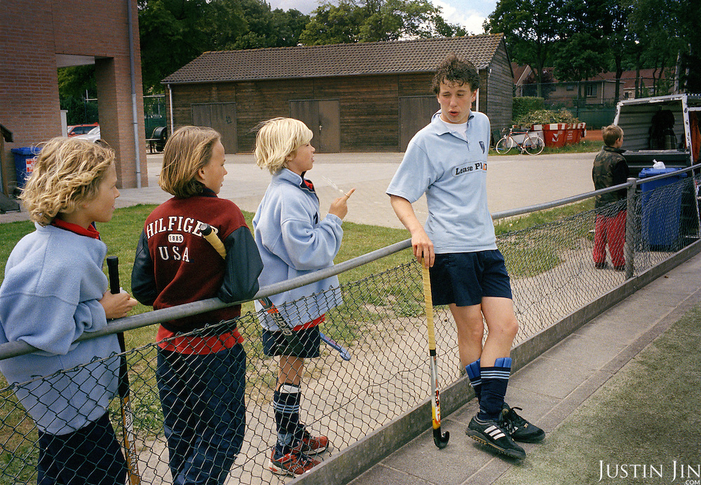 Roderick Verdonck Huffnagel, 15, talks to kids during hockey in Laren, an affluent town in the heart of the Netherlands..Roderick attends pre-university education at Willem de Zwijger College in Bussum and plays hockey in Laren. Roderick?s parents are divorced. He lives with his father and stepmother. At school he gets good grades, even though his teachers say he doesn?t work hard enough. His favourite subject is history. Later, he wants to go to university and become a lawyer. He spends his leisure time going to parties, playing hockey and football.