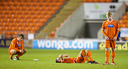 BLACKPOOL, ENGLAND - Wednesday, December 18, 2013: Blackpool players look dejected after losing to Liverpool on penalties during the FA Youth Cup 3rd Round match at Bloomfield Road. (Pic by David Rawcliffe/Propaganda)