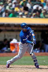 OAKLAND, CA - JULY 23:  Devon Travis #29 of the Toronto Blue Jays at bat against the Oakland Athletics during the ninth inning at O.co Coliseum on July 23, 2015 in Oakland, California. The Toronto Blue Jays defeated the Oakland Athletics 5-2. (Photo by Jason O. Watson/Getty Images) *** Local Caption *** Devon Travis