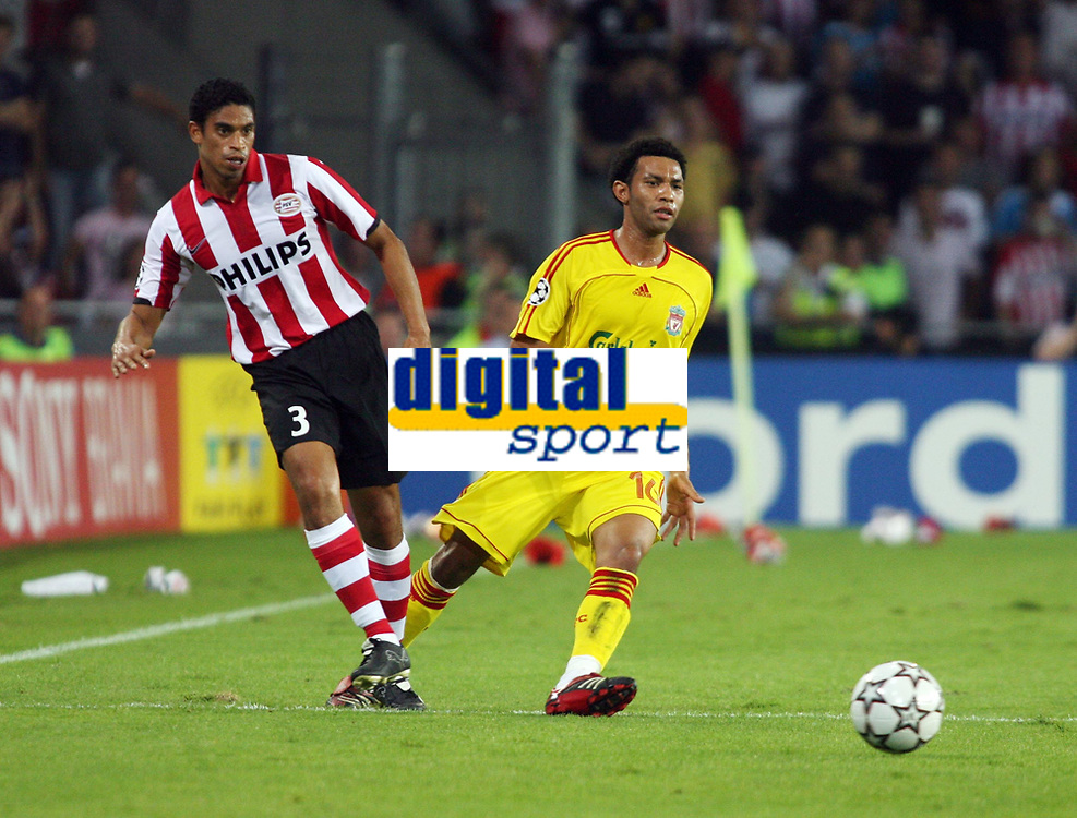Photo: Chris Ratcliffe.<br /> PSV Eindhoven v Liverpool. UEFA Champions League, Group C. 12/09/2006.<br /> Jermaine Pennant of Liverpool clashes with Michael Reiziger  of PSV Eindhoven.