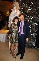 Ballerina DARCEY BUSSELL and her husband MR ANGUS FORBES at a Christmas party to celebrate the 225th Anniversary of Asprey held at their store 167 New Bond Street, London on 7th December 2006.<br />
