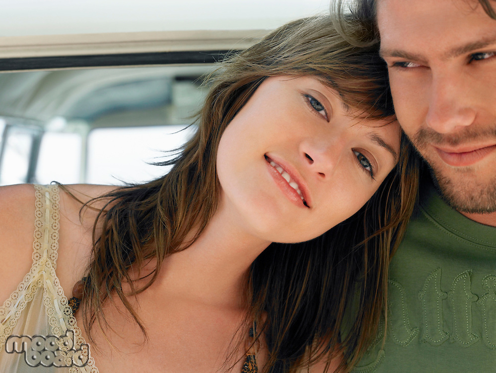 Young woman leaning on shoulder of young man head and shoulders