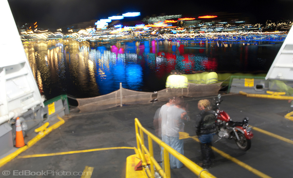 A multiple exposure of ten exposures combined to give a surreal look to downtown Bremerton as a ferry from Seattle arrives at the terminal. Puget Sound, WA, USA