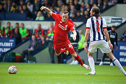 WEST BROMWICH, ENGLAND - Sunday, May 15, 2016: Liverpool's Brad Smith is shown a yellow card for simulation for this tackle from West Bromwich Albion's Jonas Olsson during the final Premier League match of the season at the Hawthorns. (Pic by David Rawcliffe/Propaganda)