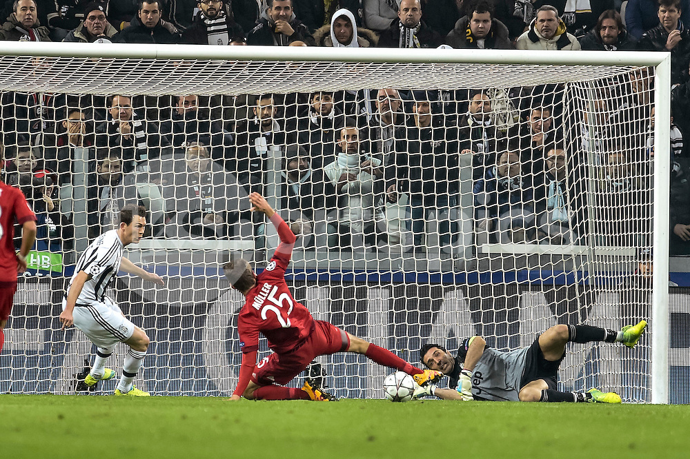 Gianluigi Buffon of Juventus saves on Thomas Muller of Bayern Munchen  during the UEFA Champions League match Round of 16 between Juventus and Bayern Munich at the Juventus Stadium, Turin, Italy on 23 February 2016. Photo by Giuseppe Maffia.